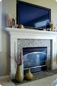 how to mount tv over fireplace and hide wires over fireplace pros and cons heat shield