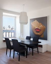 large dining room with a beauitful portrait wall art
