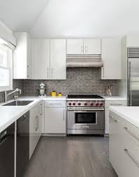 white and gray kitchen with gray mini brick tile backsplash view full size