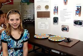 Meghan Jensen, 8, shows off her hovercraft. She experimented using the  hovercraft on different surfaces and found it worked best on a smooth wood  floor.   Citizen's News