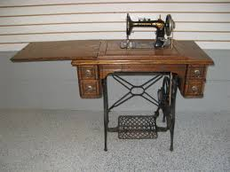 Early 1900s Minnesota D Treadle Sewing Machine and 5 Drawer Oak Cabinet  (after restoration)