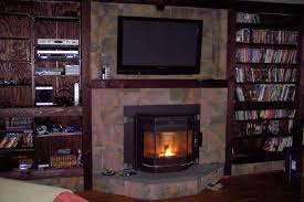 furniture fireplace designs with tv above over stone stand natural tiles and bookshelf s