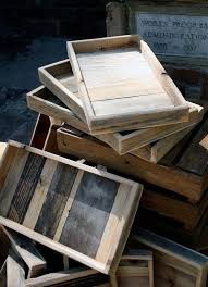 take old wood and make a wooden tray and attach handles