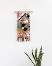 rag rug pom pom wall hanging