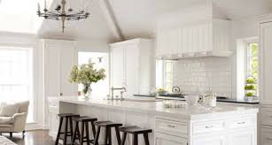 beautiful white kitchen cabinets: love this all white kitchen done in classic materials beautiful pitched ceiling and subway tiles add interest to this pretty all white kitchen
