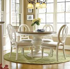 round dinner table set at wonderful extendable dining