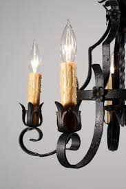 two matching antique five light tudor chandeliers in wrought iron dating from the 1920 s