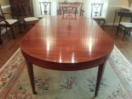 mahogany dining room table with tulip wood banding ca 1920