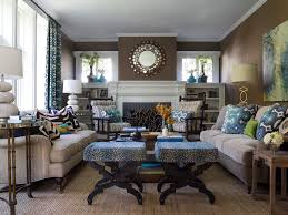 small family room decorating ideas with wall mirrors above fireplace and using brown color schemes