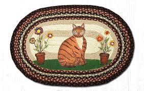 black oval jute rug folk art cat country barn