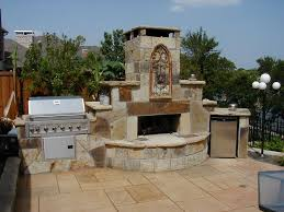 gorgeous fixed outdoor wood burning fireplace design with rustic style and outdoor kitchen set