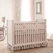exquisite design baby crib bedding ideas with white wooden baby crib and beige pink colors bedding set
