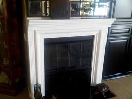 wood fireplace mantel finished in white lacquer