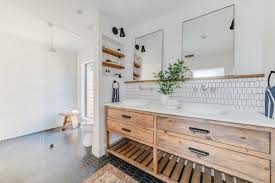 the master bath is fitted out with a custom double vanity by elite remodeling concepts