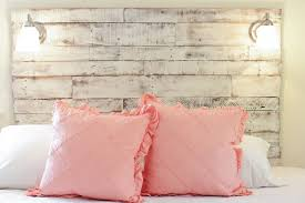 white rustic headboard how to make an easy weekend diy distressed headboard from salvaged wood pallets