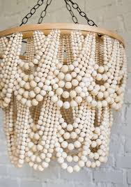 diy glam wood bead chandelier of beads of diffe sizes via thehousethatlarsbuilt com
