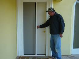 entry doors with retractable screens. awesome retractable screen door in white with golden handle matched yellow wall for home exterior entry doors screens