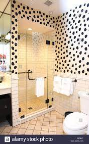 An eclectic hotel bathroom with spotted ...