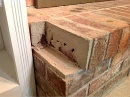 loose brick on fireplace hearth image 214389417 jpg
