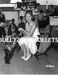 PRISCILLA LANE LEGGY SEXY WITH HER DOG 8X10 PHOTO | #132520688