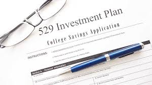529 plan form with eyegles and pen