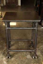 industrial iron furniture. 1stdibscom cast iron industrial table with dual wheels furniture e