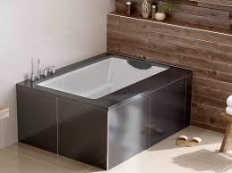 the yasahiro deep soaking tub used as a coner bath undermountedbeneath a tiled surround