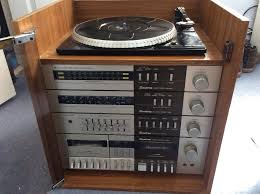 sound system table. binatone sound system, record player (turn table), radio, tape system table