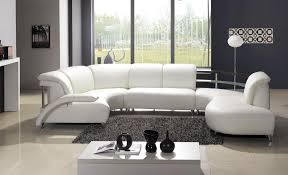 modern living room style with white leather curved sectional couch dark grey fluffy area