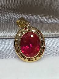 yellow gold pendant with red stone