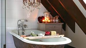 hang a chandelier over the bath for instant ambience
