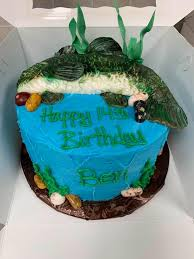 I sent the pic off to michelle at sugar rush stuff and the cake they wished for was brought to life. Angie S Li L Bakery Ben S Fish Birthday Cake For Jennifer Mattoon Facebook