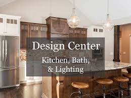 kitchen designed by wolff bros medina showroom white paint dark stain two toned kitchen