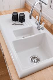 reginox overmounted ceramic sink with drainer 1 5 bowl reversible
