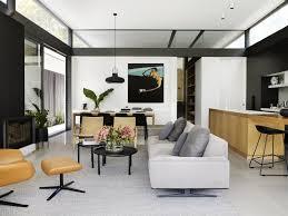 living room pendant lighting sofa standard layout fireplace ottomans rug floor