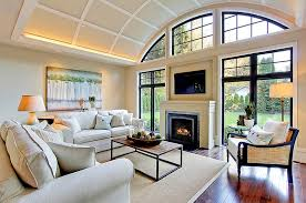 view in gallery ambient lighting plays a major role in the living room with tv above fireplace