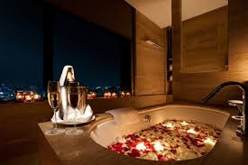 a room in conrad seoul with a bath tub decorated with flower leaves for valentine s day courtesy of conrad seoul