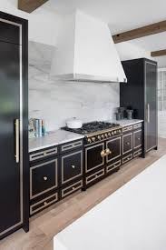 custom kitchen cabinets and range hood on the minnesota 2018 artisan home tour