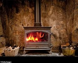 scientists have found that wood burning stoves are choking the british atmosphere adding to the