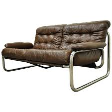 mid century modern brown leather tubular chrome settee after rodney kinsman for