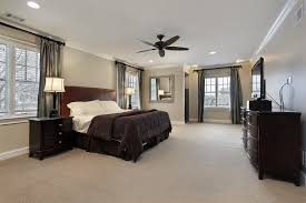 white bedroom with dark furniture. plenty of windows in this room ensures a bedroom space that will never need for natural white with dark furniture n