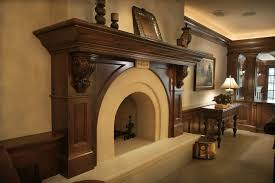 dark wood fireplace mantel family room traditional with dark stained wood carved stone wainscot
