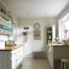 galley kitchen styles work just as well in country schemes as modern this quaint kitchen space is bright and fresh with neutral walls and cabinetry