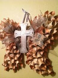 book page angel wings with cross find this pin and more on book pages repurposed