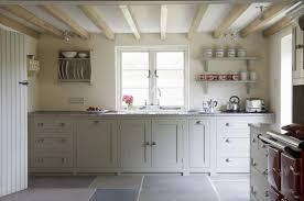 Floor To Ceiling Kitchen Units 3alhkecom A White Country Kitchen Cabinets And Pretty Flowers