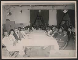 looking back on the bus boycott library of congress blog rosa and raymond parks seated at a banquet table left side third and