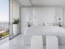 luxurious white bedroom with big stylish bed and lovely stools along with fantastic lamps and fresh captivating white bedroom