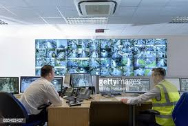 Small Picture Security Guard In Security Control Room With Video Wall Stock