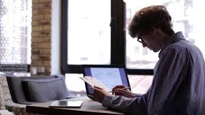office space computer. Man Checks Drawings Using A Laptop - HD Stock Footage Clip Office Space Computer