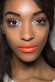 white eyeshadow and orange lipstick